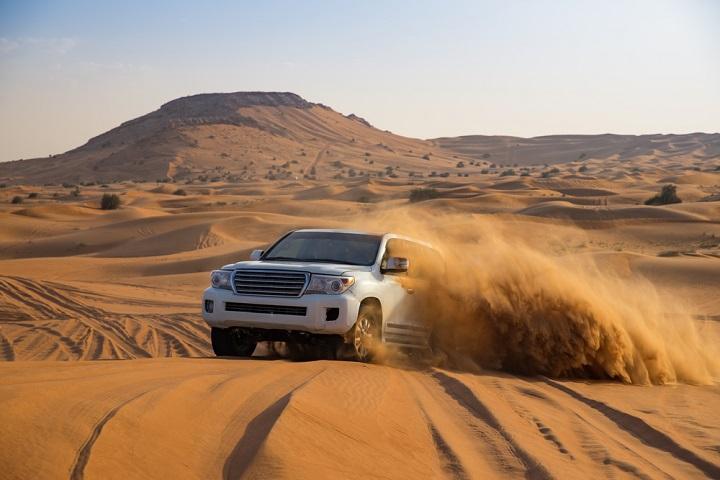 Car in Dubai sand dunes