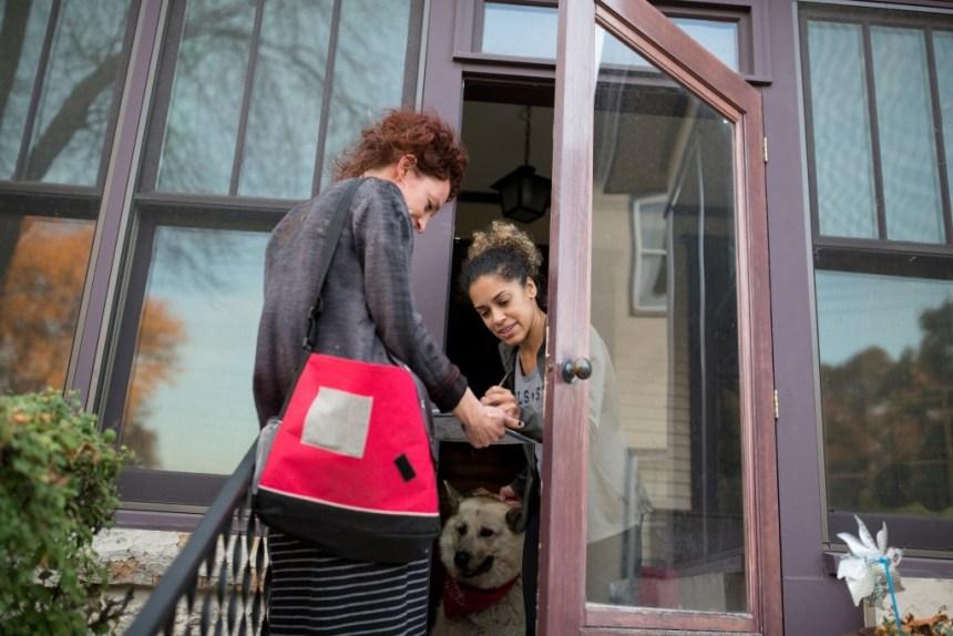 Ginger Jentzen speaks with Lyssa Washington while she canvased the neighborhood in Minneapolis, Minnesota, on October 20, 2017.