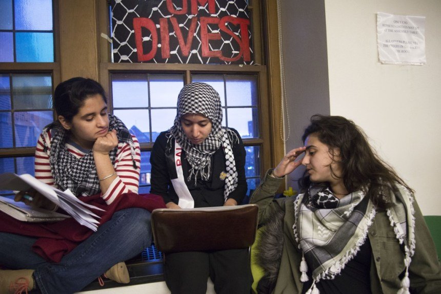 University of Michigan students participate in a sit in to divest from companies that have supported human rights violations against Palestinians on March 20, 2014.