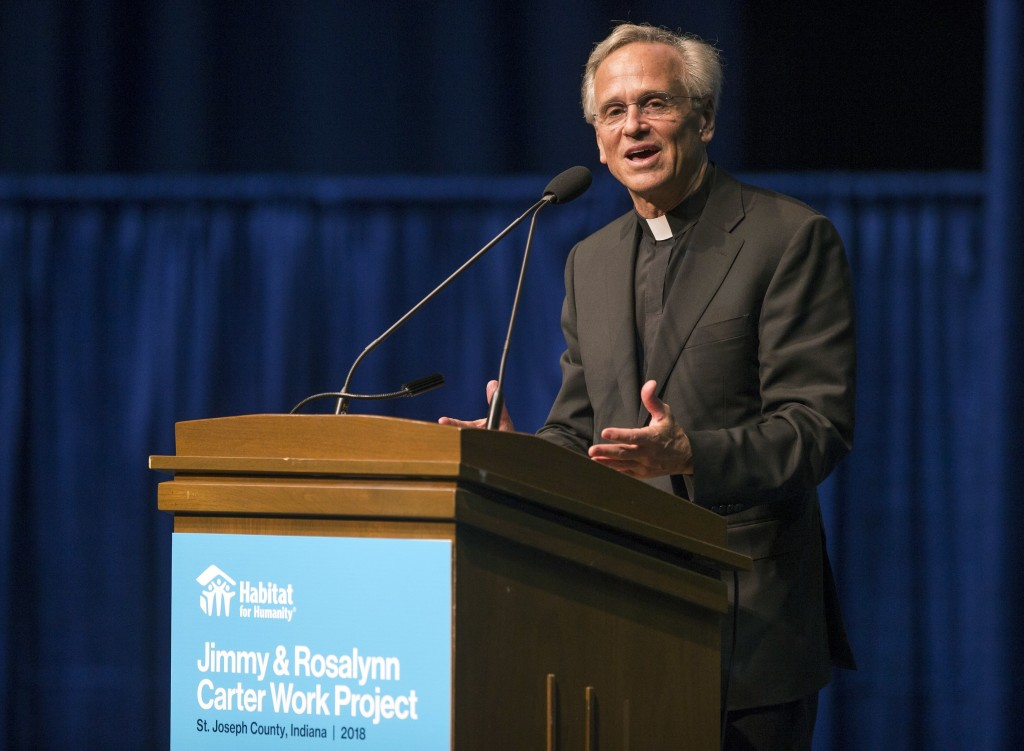 Notre Dame President Rev. John I. Jenkins speaks during the opening ceremony event for the Jimmy & Rosalynn Carter Work Project on Sunday, Aug. 26, 2018, inside the University of Notre Dame's Purcell Pavilion in South Bend, Ind. (Robert Franklin/South Bend Tribune via AP)