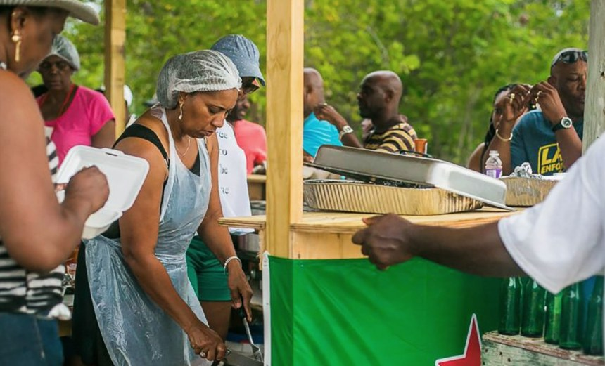 Anguilla locals prepare and enjoy a Caribbean cookout at the 2016 West fest along Meads Bay, Anguilla on August 04, 2016.