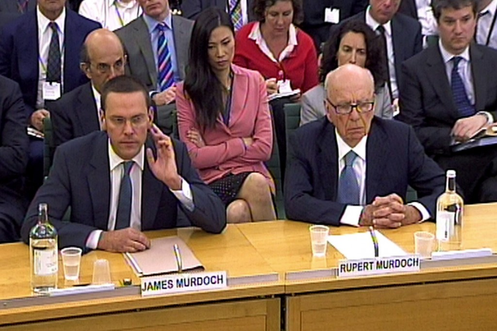Phone hacking claims. James Murdoch (left) , Deputy Chief Operating Officer and Chairman and Chief Executive Officer, International News Corporation and Rupert Murdoch, Chairman and Chief Executive Officer, News Corporation giving evidence to the Culture, Media and Sport Select Committee in the House of Commons in central London on the News of the World phone-hacking scandal. Picture date: Tuesday July 19 2011. Photo credit should read: PA Wire URN:11226198