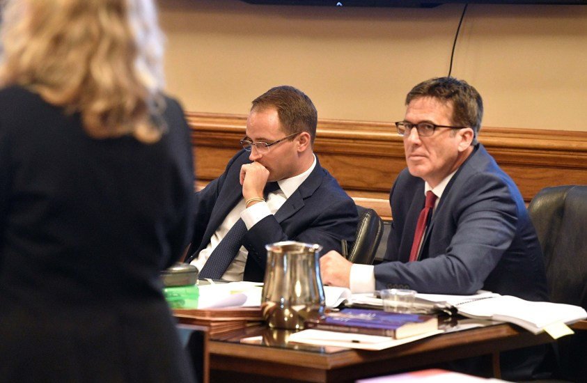 July 23, 2018; Nashville, TN, USA; Assistant Attorney General Rob Mitchell andDeputy Attorney General Scott Sutherland listen as Federal Public Defender Kelley Henry speaks during a lawsuit brought on by death row inmates contesting the use of lethal injection as unconstitutional because, they say, it would lead to cruel and unusual punishment, at Chancery Court Part lll, Metro City Hall. Mandatory Credit: Larry McCormack/The Tennessean via USA TODAY NETWORK