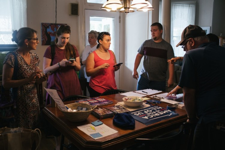 Volunteers gather to canvas for Jess King, a first-time candidate running for Congress in Pennsylvania's 11th District, at another volunteer's home in Mount Joy, Pennsylvania on Saturday, August 18, 2018. King, who lives in nearby Lancaster, is running as a progressive Democrat.(Michelle Gustafson for The Intercept)
