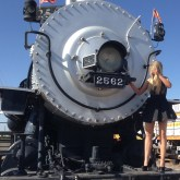 Dwarfed by locomotive.