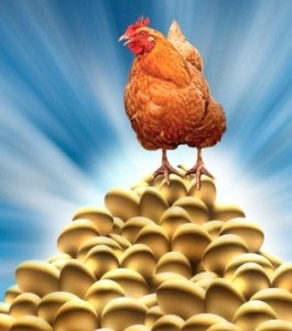Chicken laying golden eggs --- Image by © Mike Agliolo/Corbis