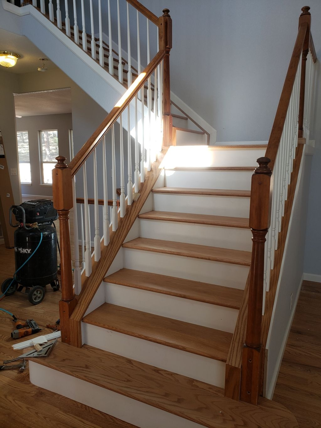 Creations Hardwoods Colorado Springs Co   Staircase Refinishing Near Me   Basement   Restaining   Brown Stained   White Riser   Grey Flooring