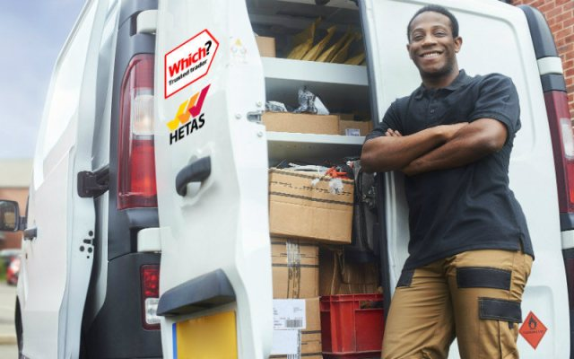 Trader with Trusted Traders and HETAS logos on his van