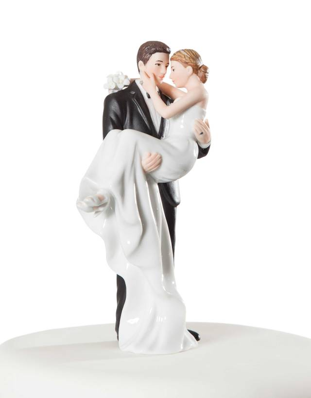 porcelain groom holding bride