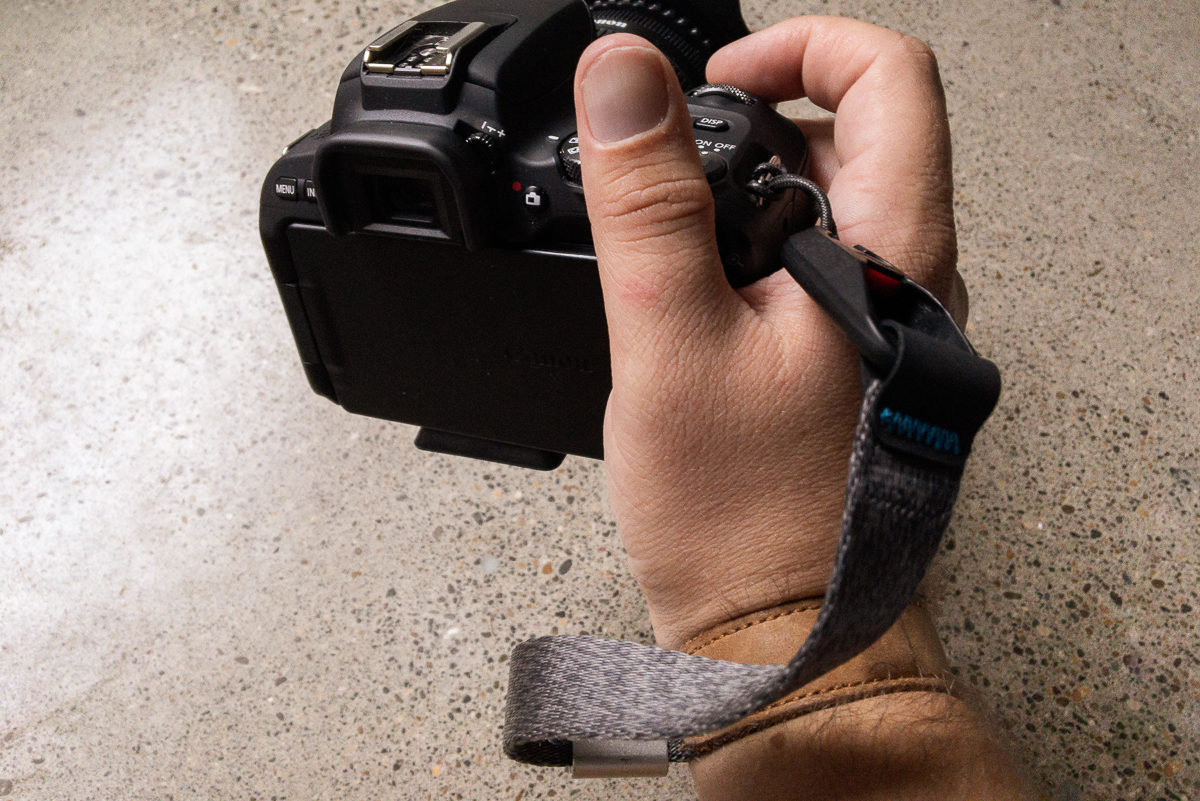 Peak Design Cuff EDC camera strap connecting camera to wrist