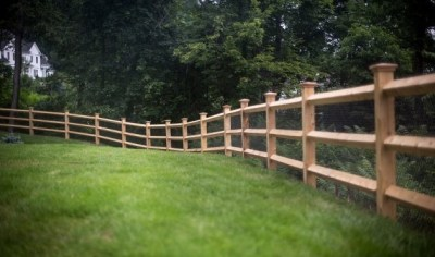 Eastern Cedar post and rail fence with diamond shaped rails (rail ends are dowled) is sold with 5x5 posts and is offered in 2 or 3 rail versions. Of course, matching gates are also available.