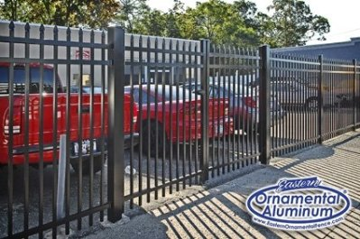Eastern Ornamental Aluminum offers a  Commercial Grade Fence. As shown here in 6 foot height, a 10 foot wide double drive gate hung from 4x4 posts.  2-1/2 inch line posts can also be seen.