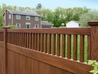 Wood grain vinyl fence by Grand Illusions Vinyl WoodBond