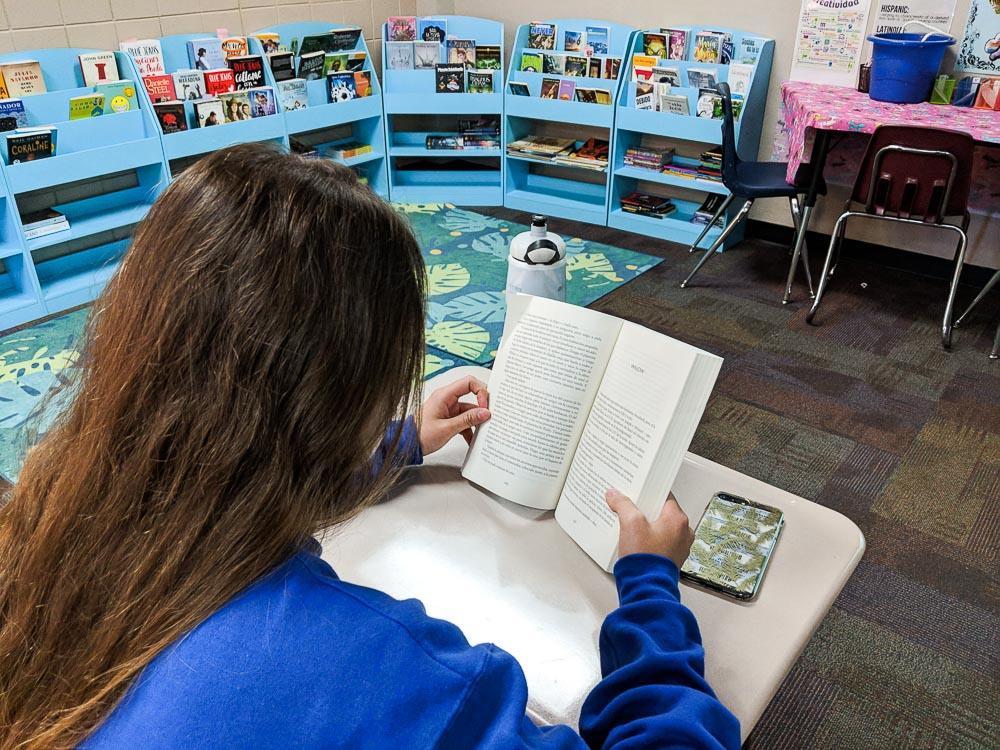 female latina student reading