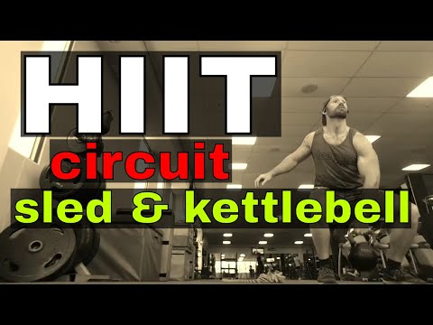 HIIT circuit – sled pull, sled push, field jump, kettlebell snatch.