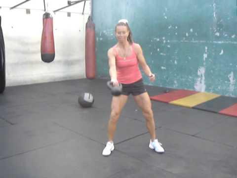 Tennis Fitness: Suzanna flipping kettlebell underhand between the legs