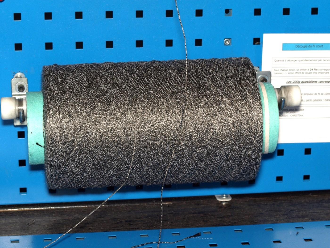 Roll of raw carbon fiber thread