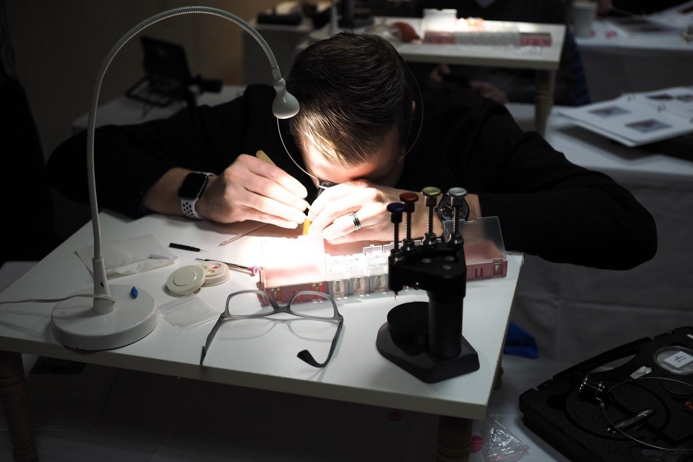 AWCI President Aaron Recksiek working on a watch movement