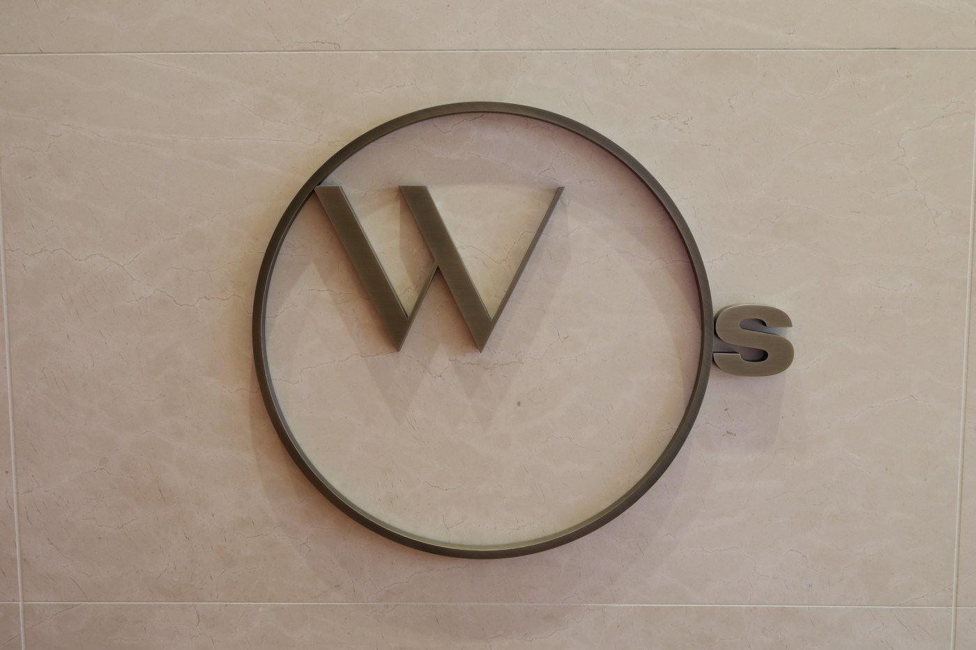 Watches of Switzerland logo on Spanish marble exterior wall