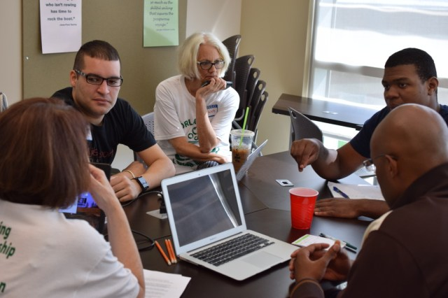 Mentors working with teams at Orlando Startup Weekend Education