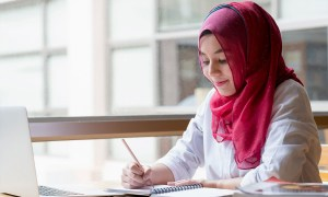 Women in hijab at desk