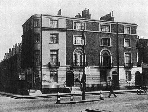 Number 2 (left), Euston Grove within building (numbers 1-4) on east side of the road. Photograph, no date.