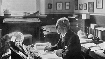Profesor Karl Pearson at desk in Francis Galton Laboratory for National Eugenics