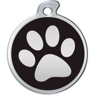 Billede af rundt hundetegn med aftryk af pote på sort baggrund.