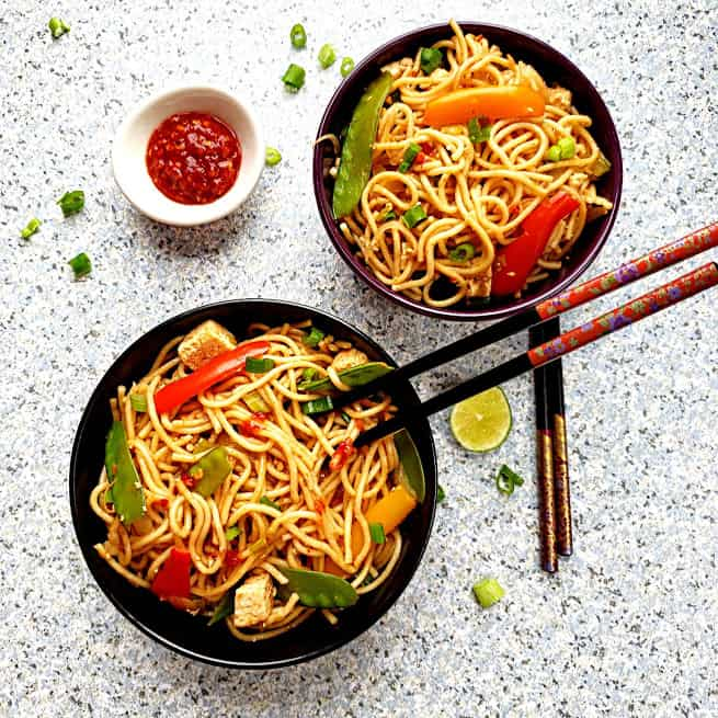Overhead shot of Chili Garlic Chinese Noodles served into two bowls