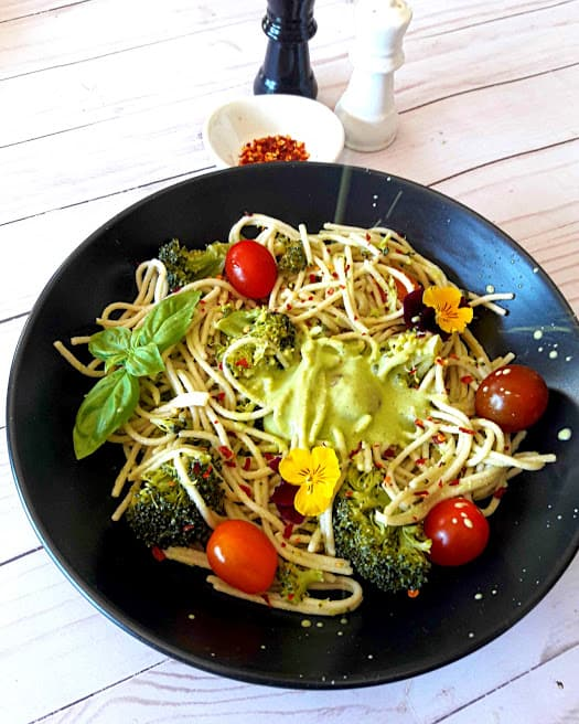 Cashew Lemon Basil dressing poured over spaghetti and veggies . This delicious dinner recipe is by ProfusionCurry