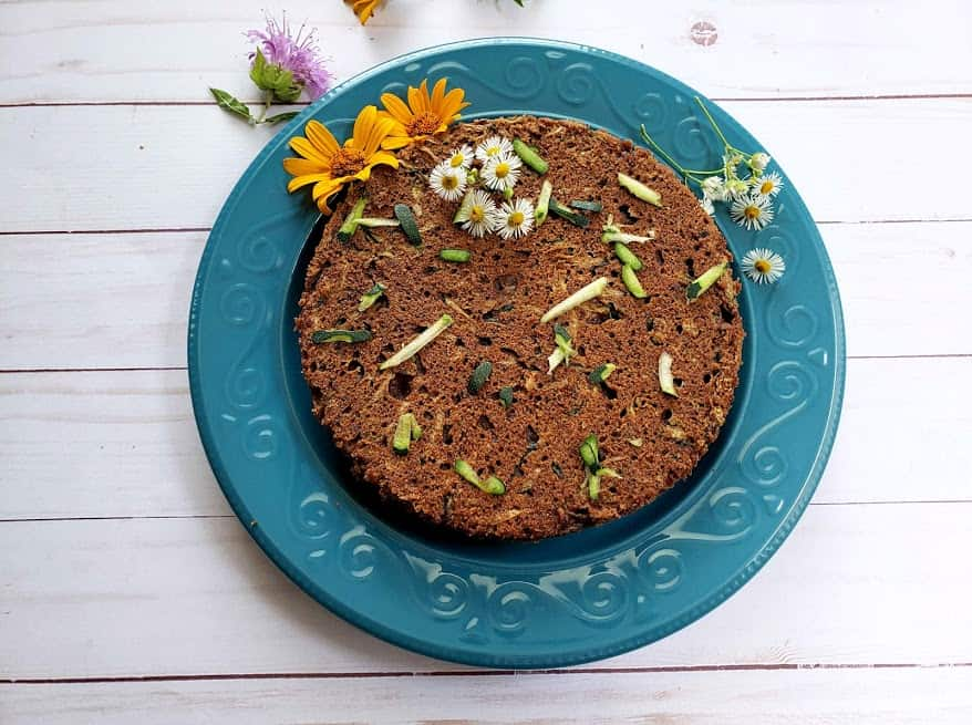 Decadent Chocolaty Zucchini bread served over blue plate decorated with colorful flowers