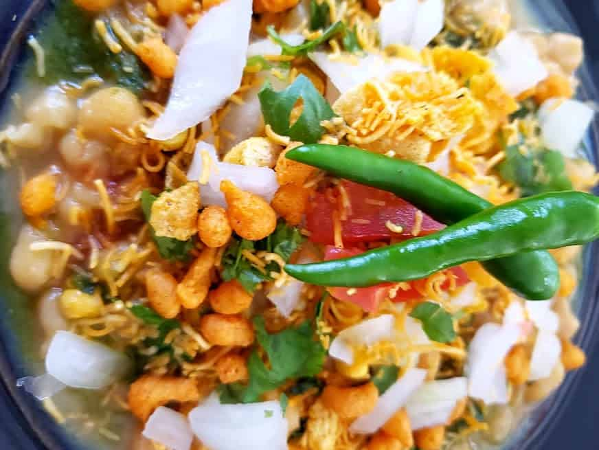 Close up photo displaying different layers and textures of Matar Chaat.