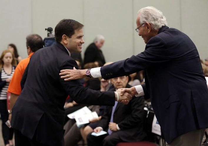 Marco Rubio y el magnate Norman Braman / AP.