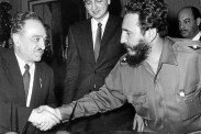 Mikoyan and Fidel shaking hands.
