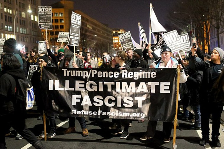 Protestors march near Donald Trump's Washington DC hotel on January 19