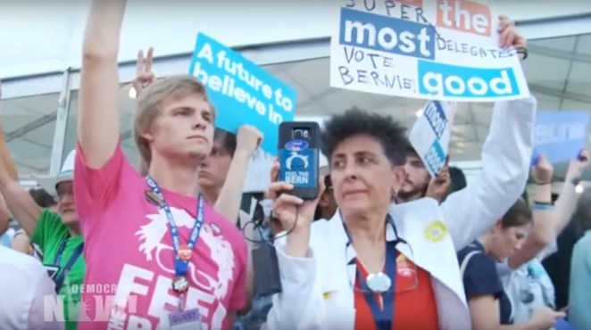 Marggie participates in the Bernie delegate walk out at the Democratic National Convention.