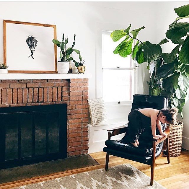 photo of child climbing on chair in stylized living room