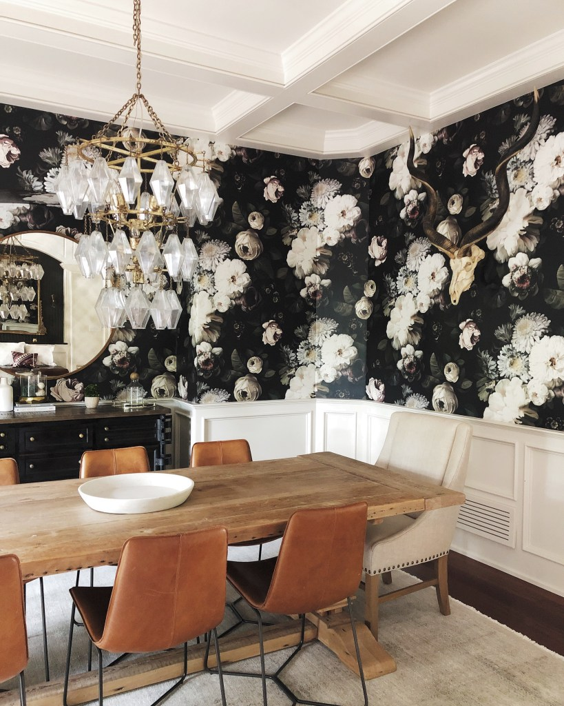 Stylized dining room with wood table, leather dining room chairs and Ellie Cashman Design Wallpaper.