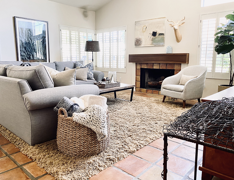 The entertainment room has a fireplace, large run with sofa and accent chair angled into the space.