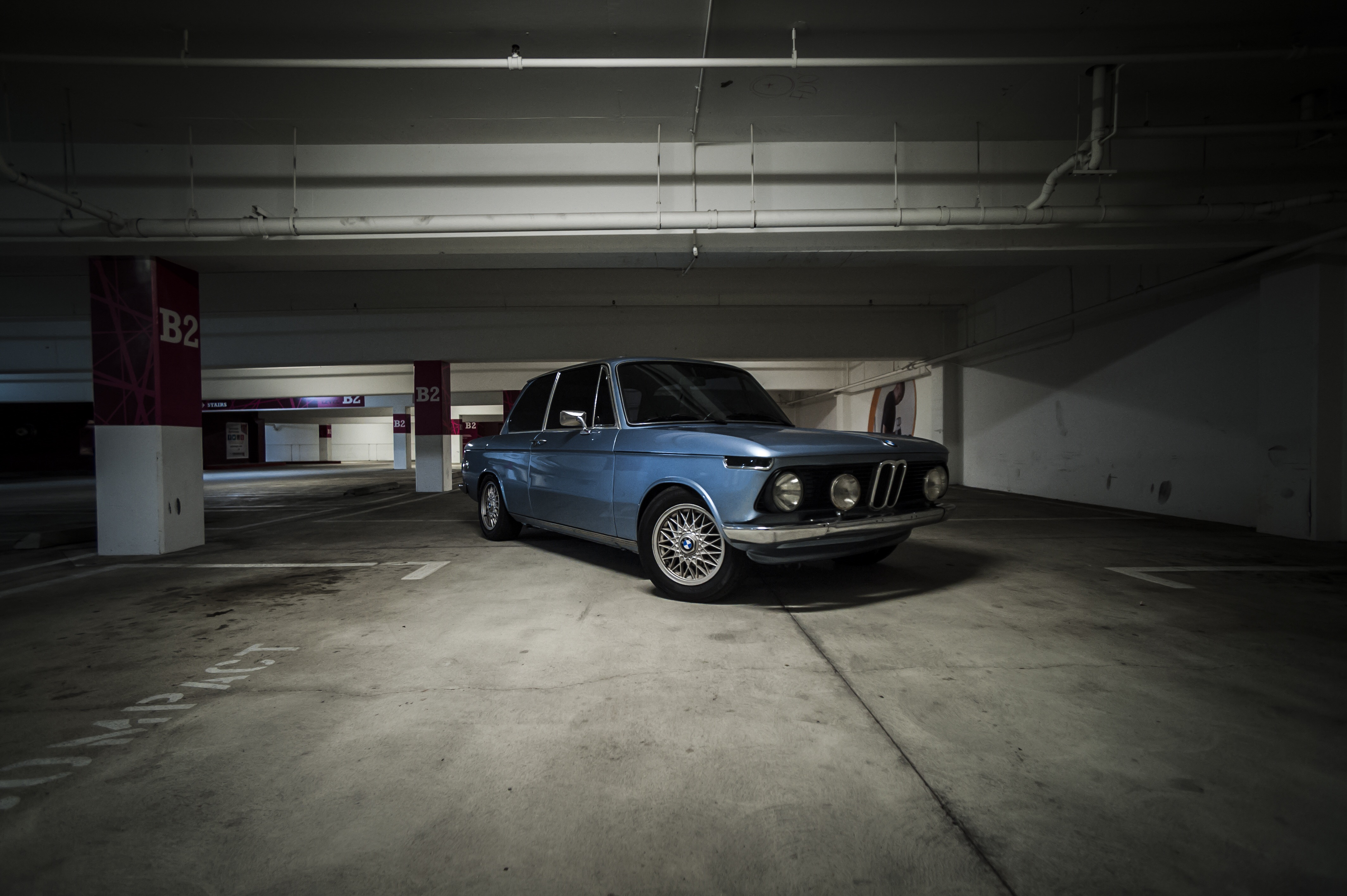 1976 BMW 2002 fjord blue parking lot