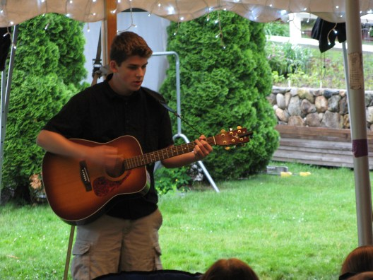Travis playing his guitar.