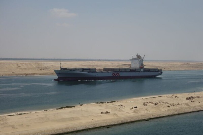 A lightly loaded containership from OOCL pictured here in the new expanded Suez Canal, going north towards Europe.