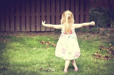 Girl dances in the grass on Easter NotSoSAHM
