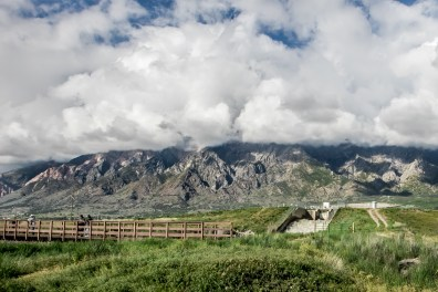 Clouds cover the mountains north of Salt Lake City, Utah, while several men stand on a bridge in the foreground NotSoSAHM