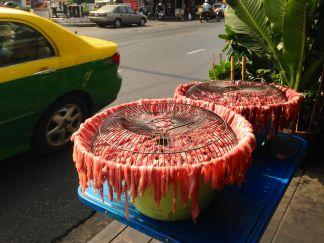 Cooking meat on the street (ek!)