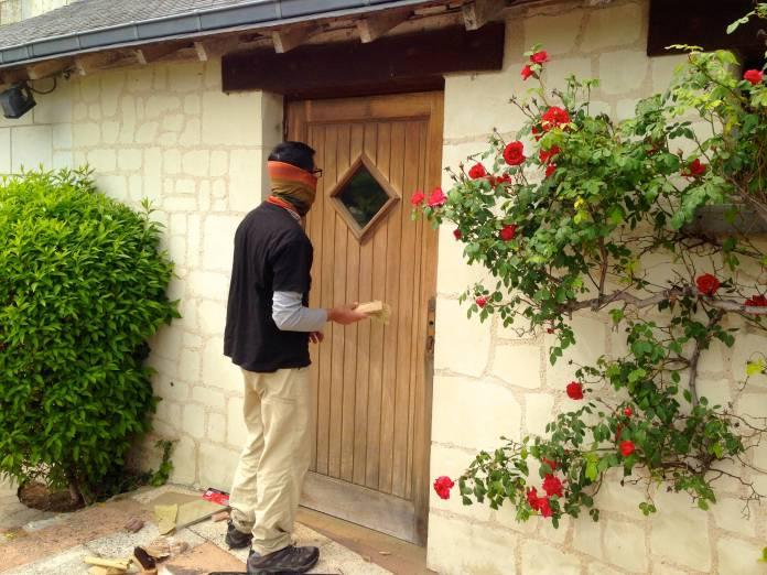 Sanding the doors to the restaurant