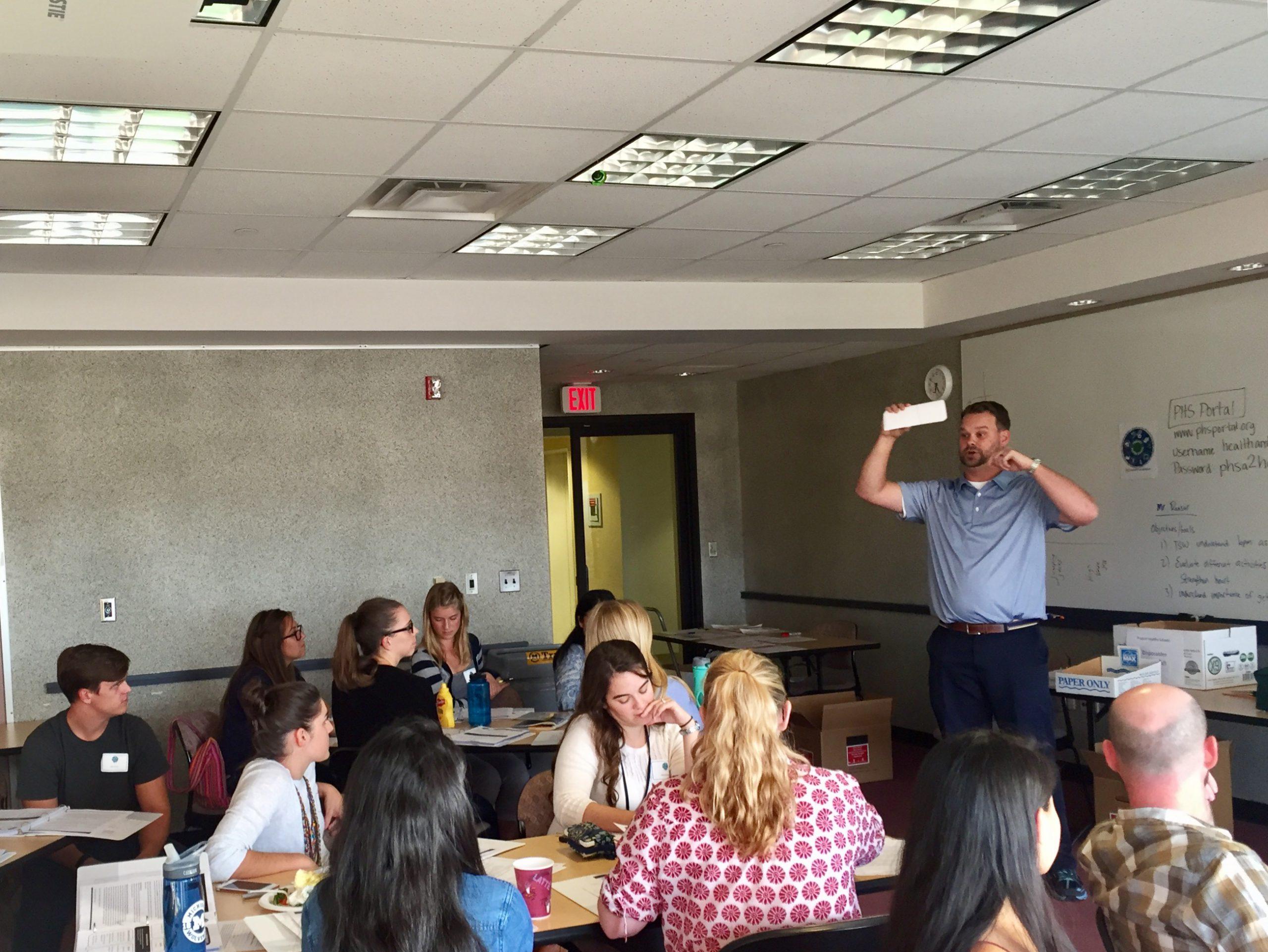 Ben teaching HAs classroom skills SIGNED
