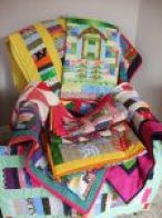 Pile of donated quilts
