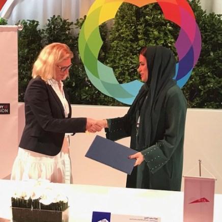Rebecca Fox, head of membership at APM signing the memorandum with RTA