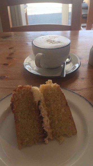 we both enjoyed a lovely Victoria sponge cake and coffee, with a sea view